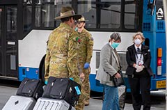 9RQR soldiers assist the movement of international arrivals into quarantine at Brisbane