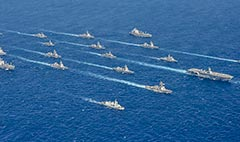 warships in formation during AnnualEx 19.